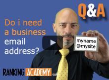 Luc durand holding a business card with a business email address written on it
